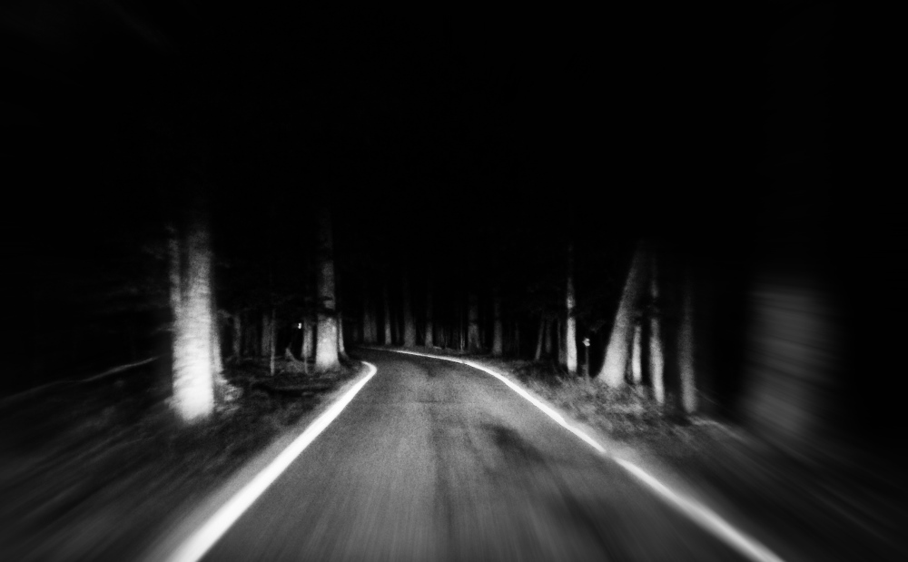 image of a dark unfrequented road true ghost story