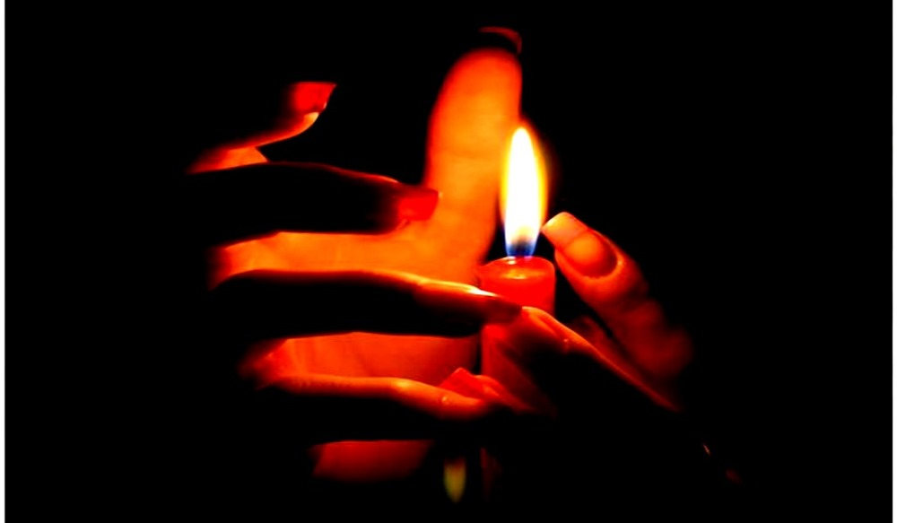 image of ghost hands around a candle indian ghost