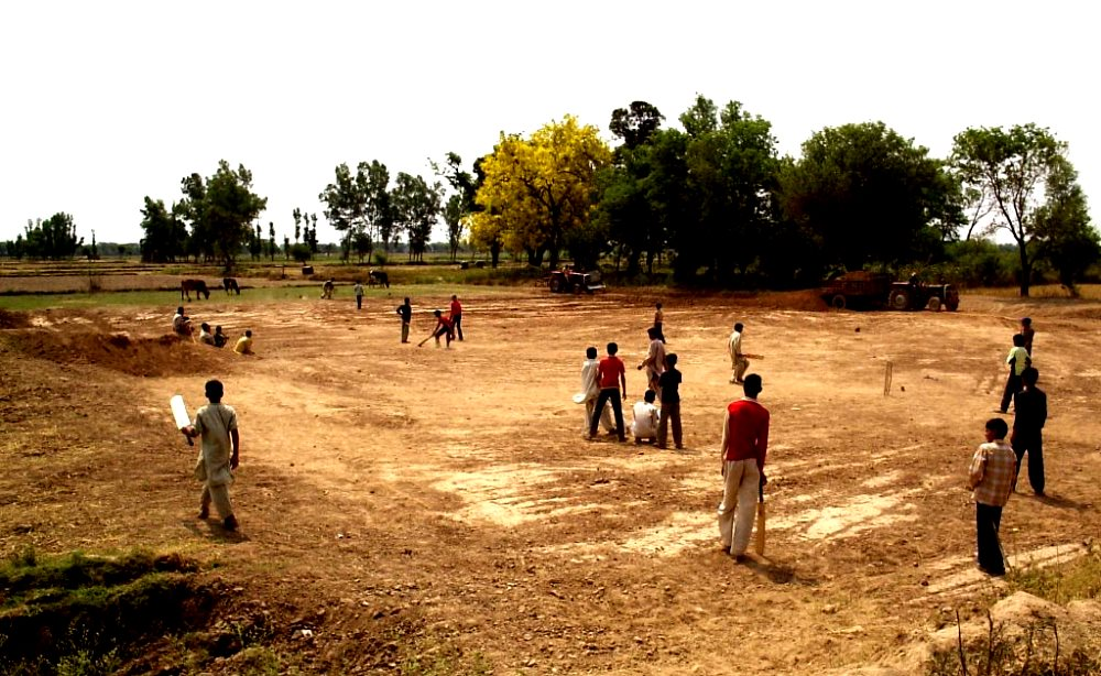 image of children playing cricket in a village ground short scary stories