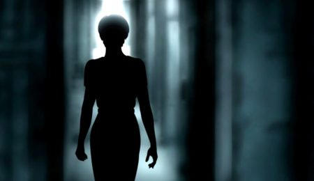 image of a woman standing in the dark the first wife